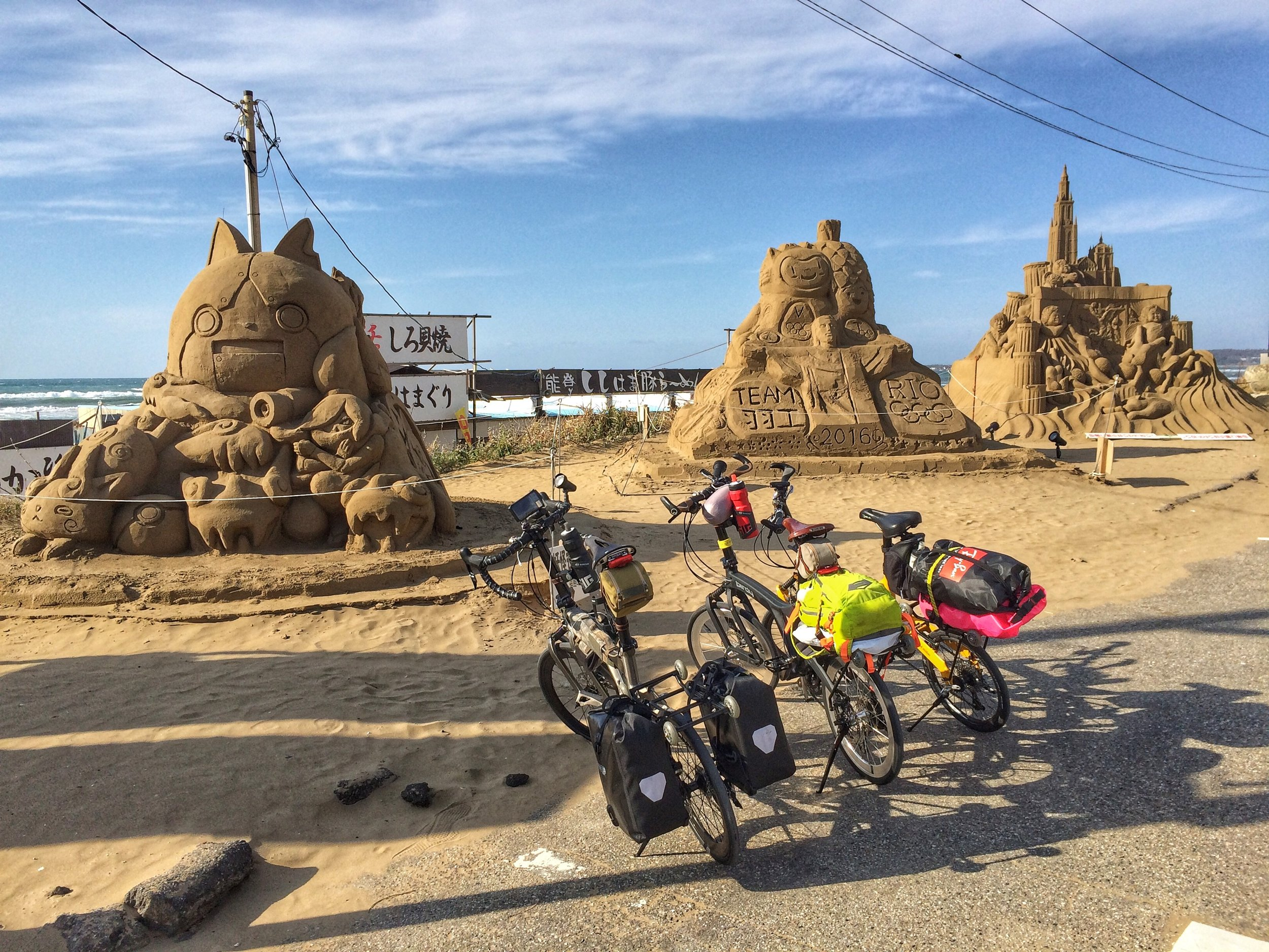 Making a stop for food and also admiring the sand sculptures!
