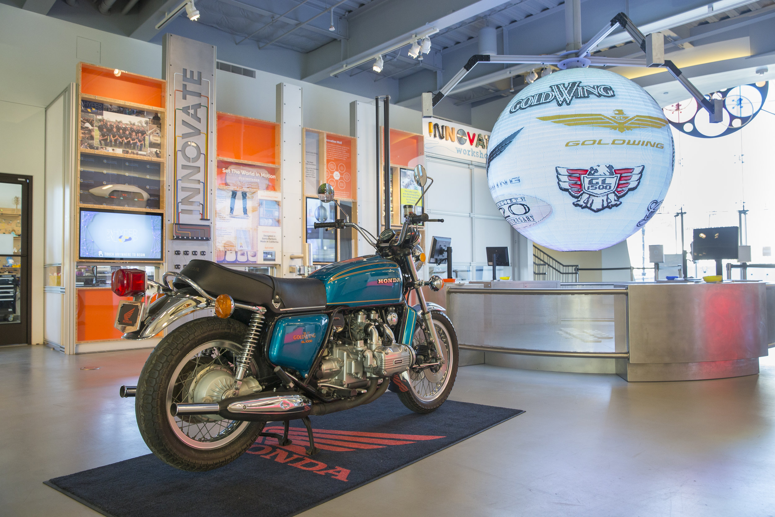 "For the unveiling, the MOXI's largest corporate event to date, the facility's entryway ""handprint globe"" was revised with heritage Gold Wing logos.  Image: Kevin Wing"