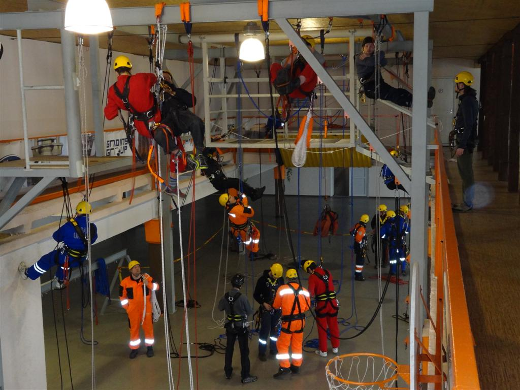Abseilers carrying out rope access training at a training centre.
