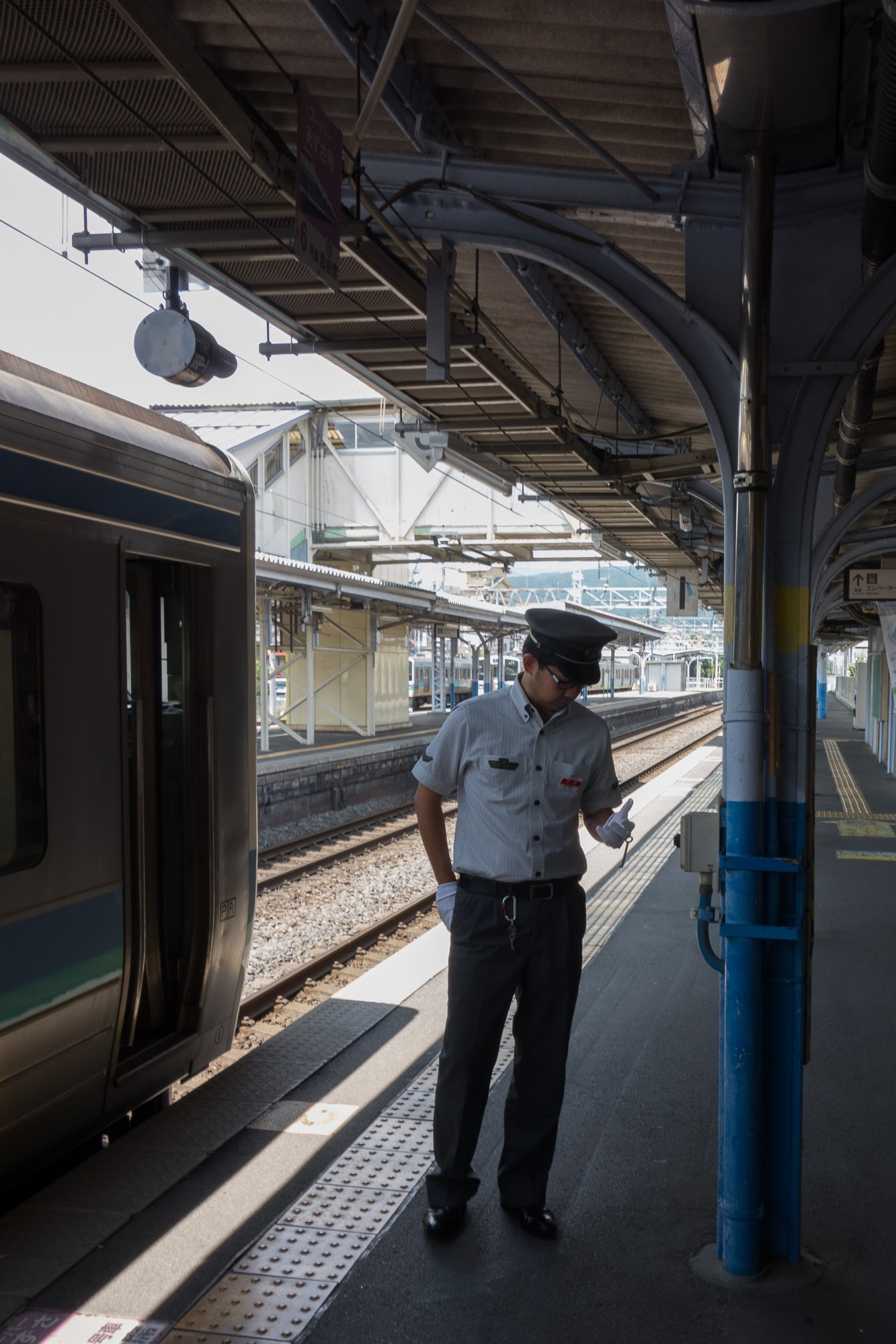 Conductor at Shimo-Suwa Station