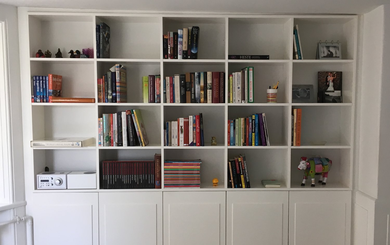 bookcase after - books arranged in happy direction 📈