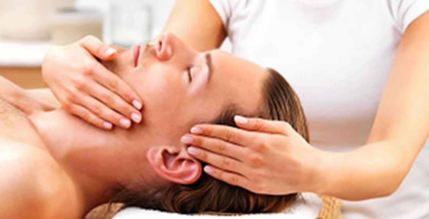 Professional head massage is performed by masseuse therapist to a client seeking thai wellness techniques.