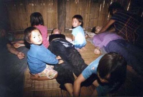thai-children-performing-traditional-thai-massage-in-village
