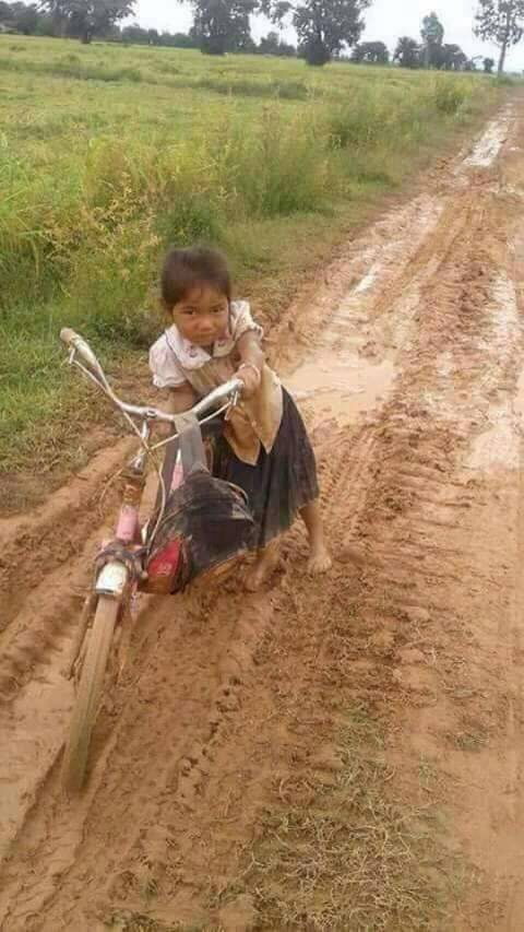 Lamai going to school in the mud