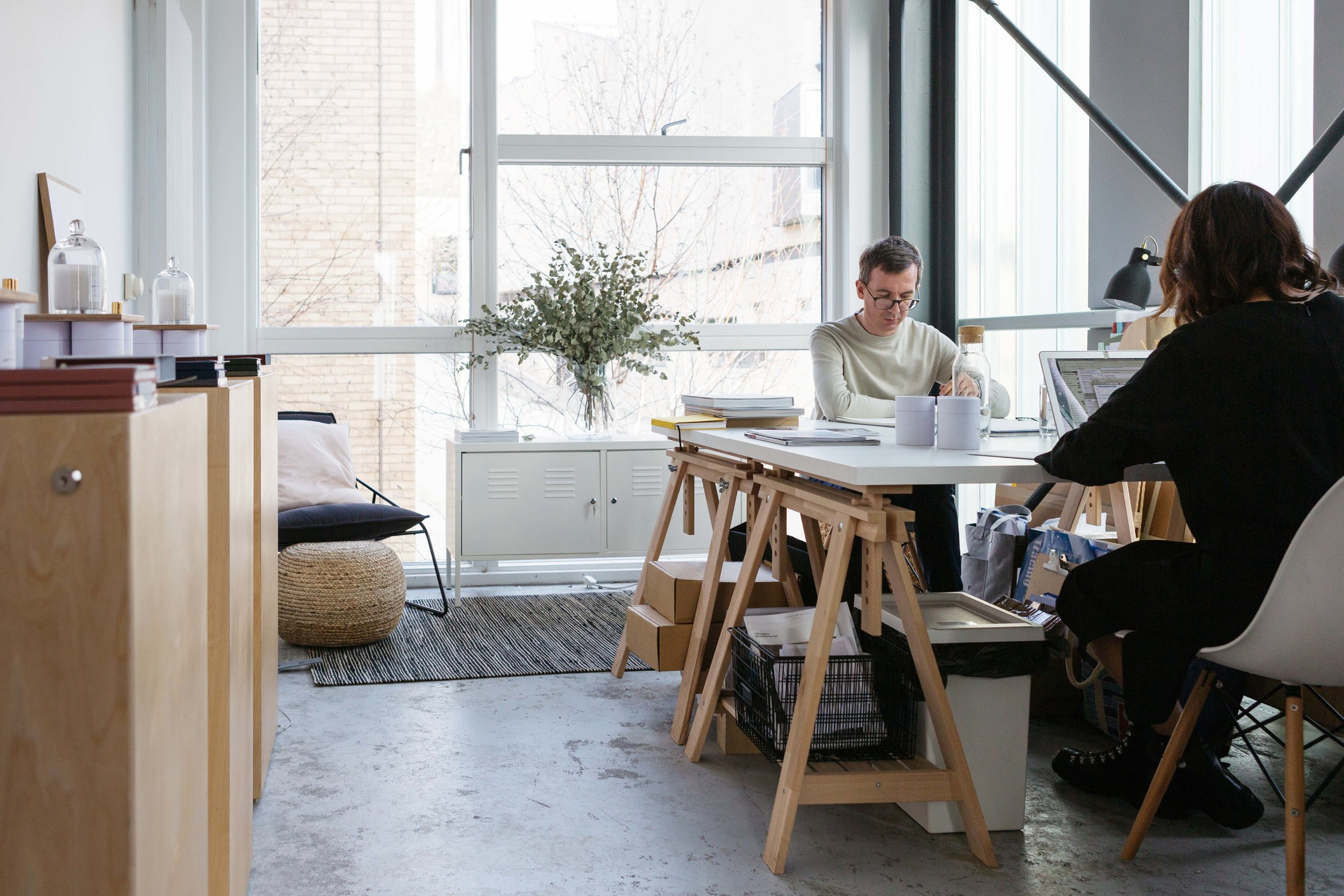The Moments of Sense & Style, Lincoln, studio. Image of the co-founders Syreeta and Rob working at their desks. Image by Natasha Boyes Photography