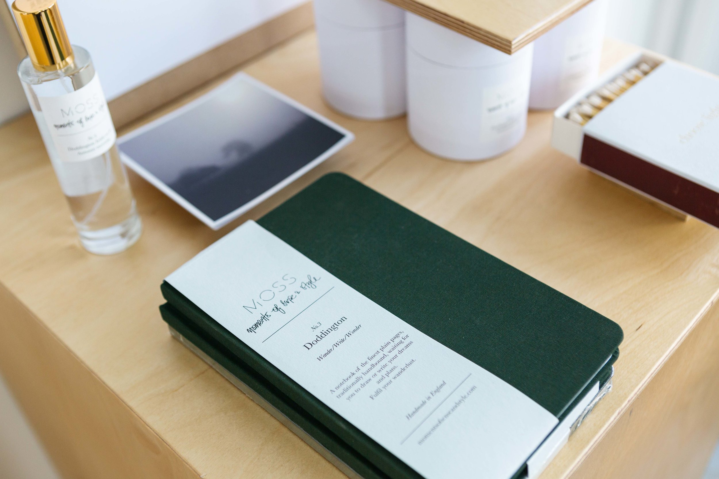 Luxury notepad and other products photographed on top of a plinth with natural light by Natasha Boyes, Nottingham