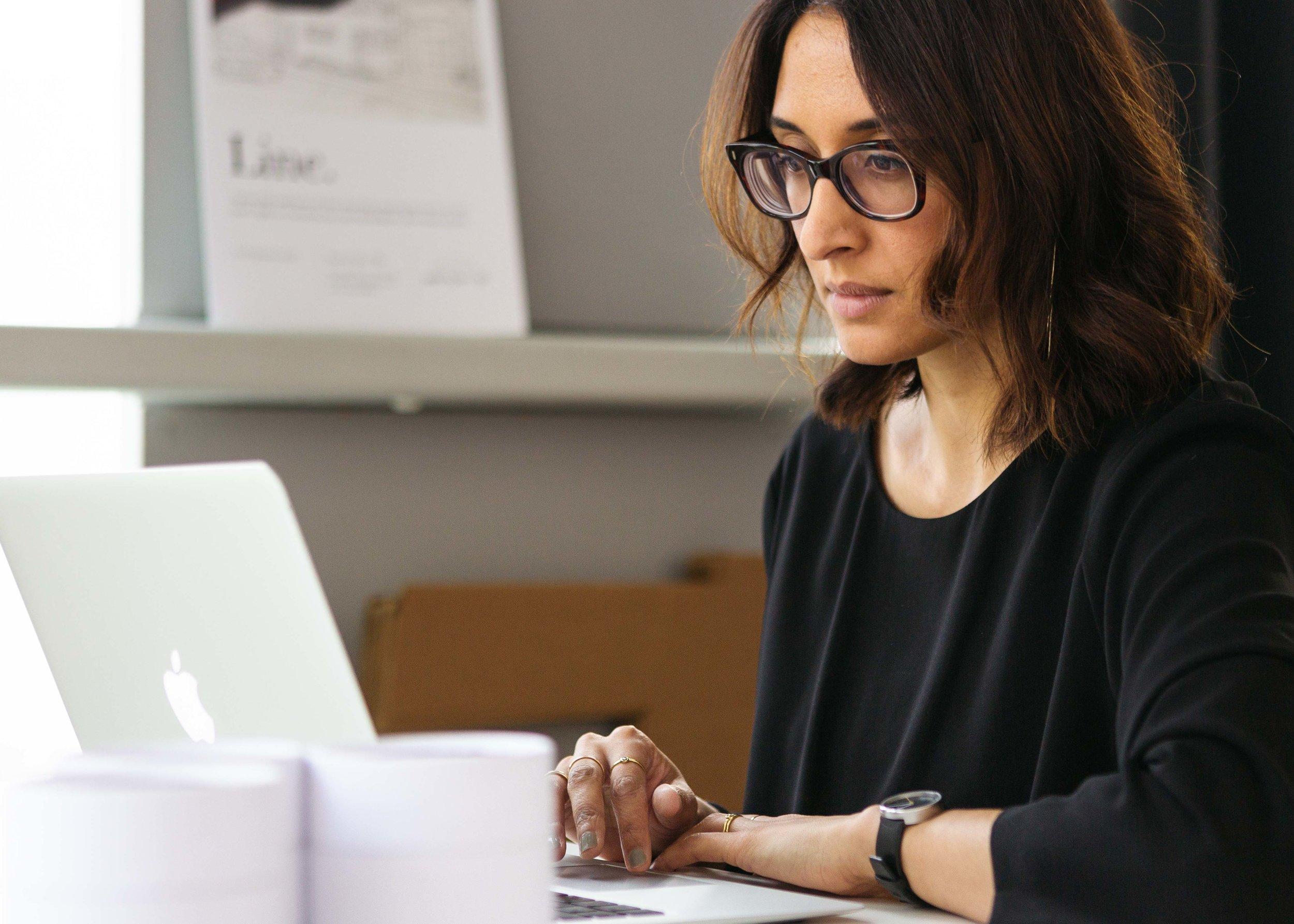 Woman working at table in her studio. Natasha Boyes Photography