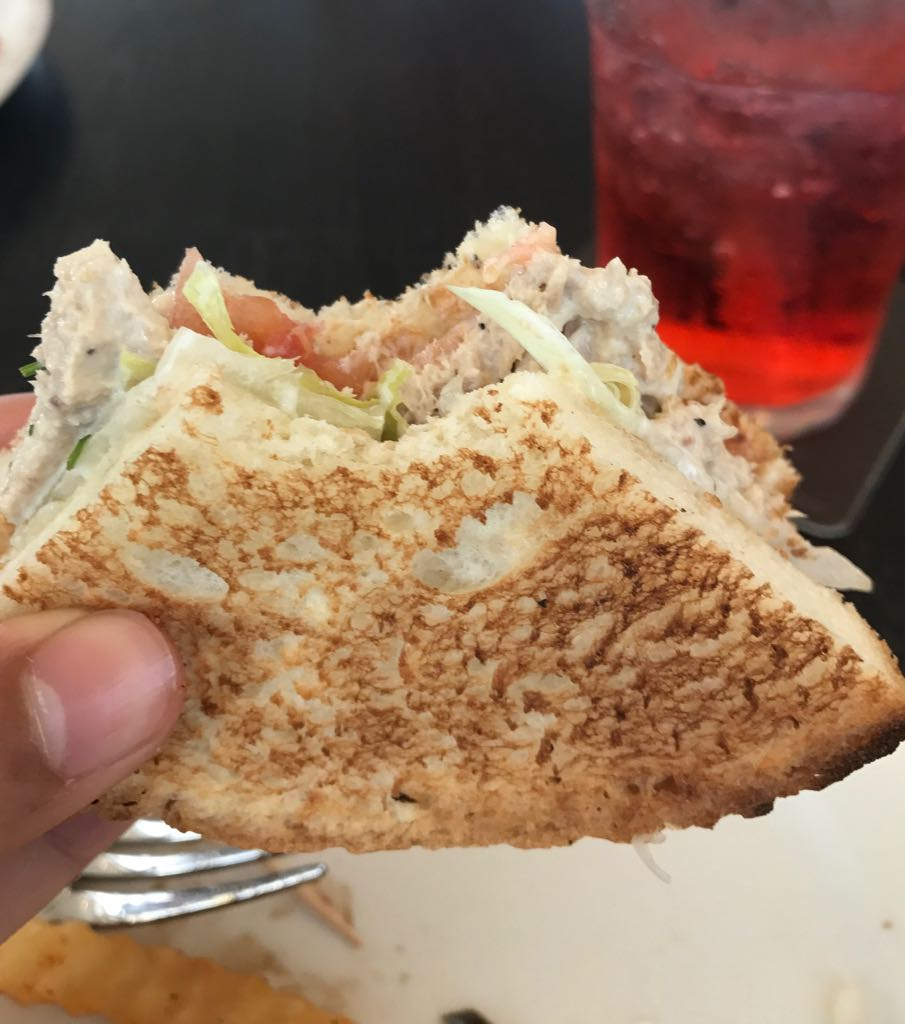 Thai chicken sandwich with a bite.jpeg