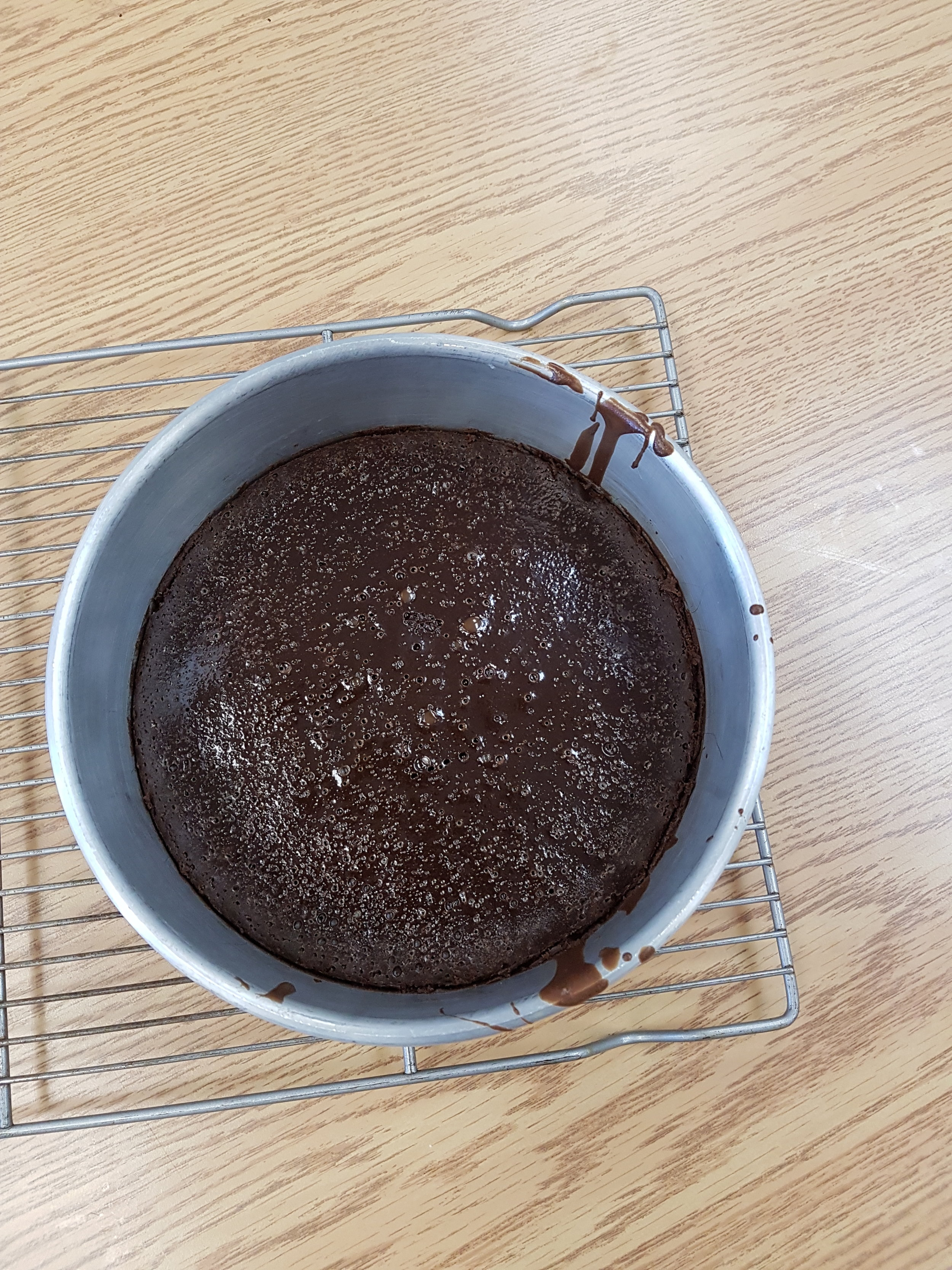 Kayla's cake out of the oven.jpg