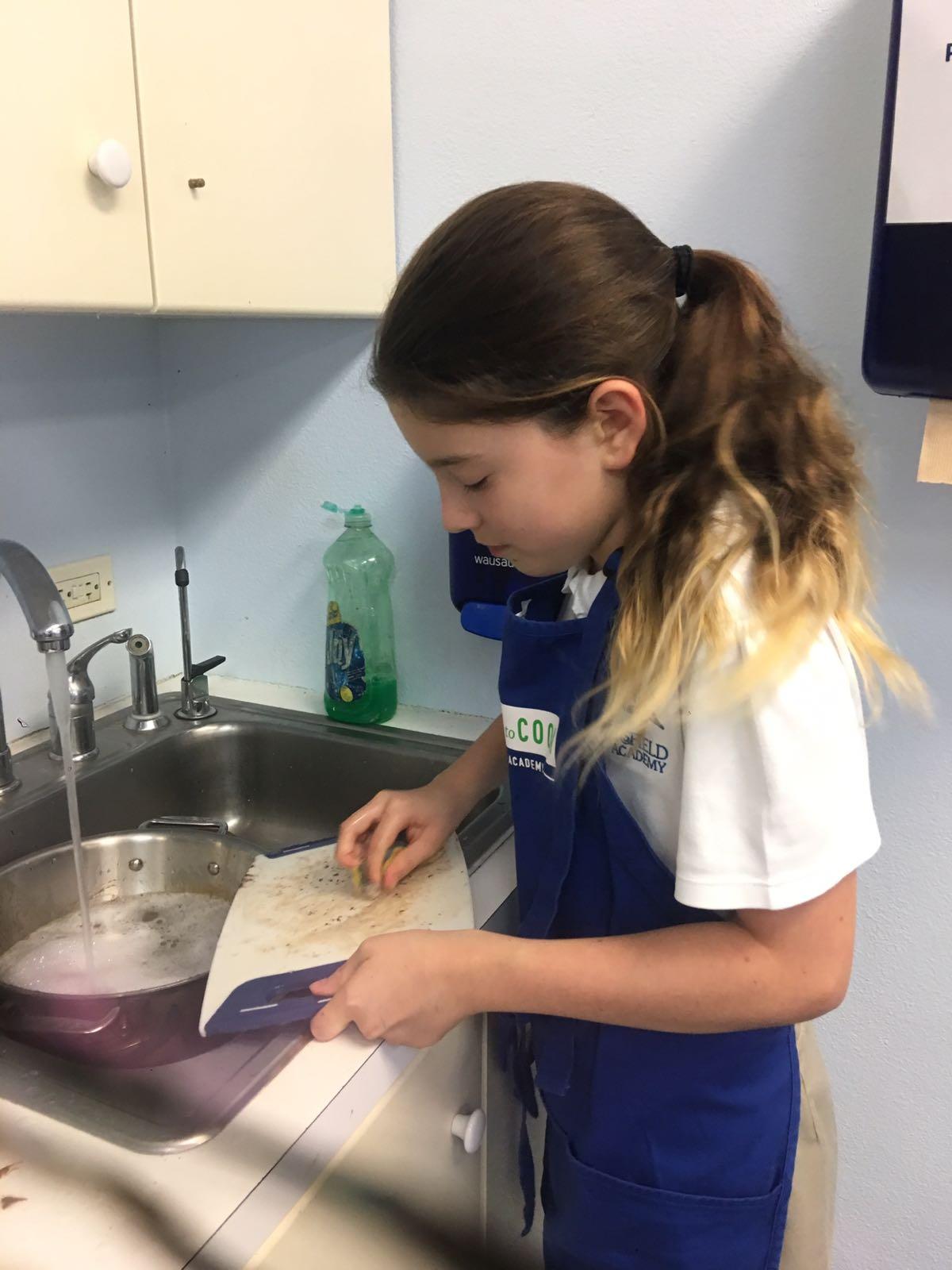 Kayla washing dishes.jpeg