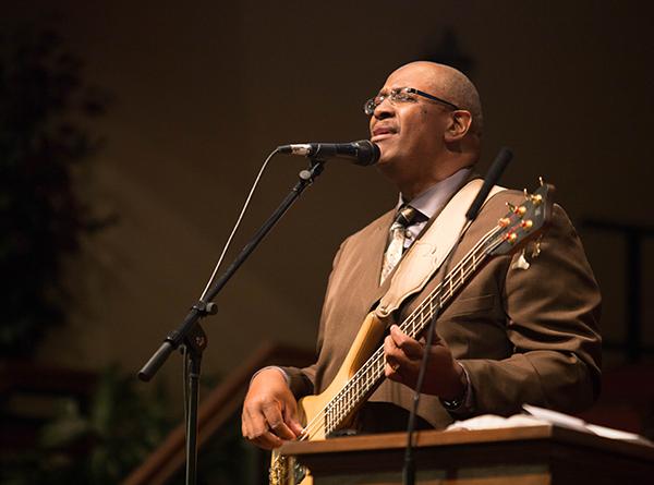 performing at asbury, brown suit, with guitar, color.jpg