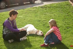 Christi Dudzik, Healing Paws CEO, helping a child with dog phobia