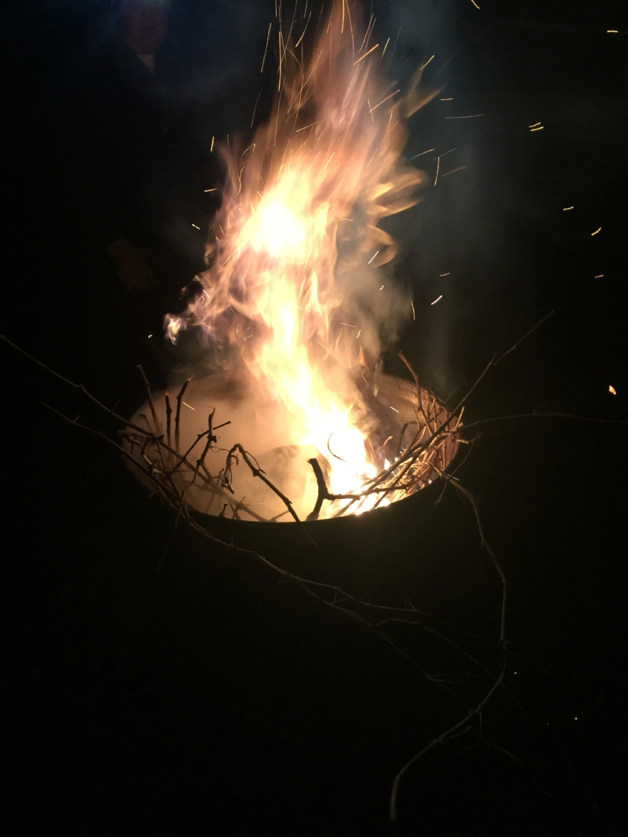 A Dulcius giant smudge pot- aflame with pruning twigs at 3:00am.