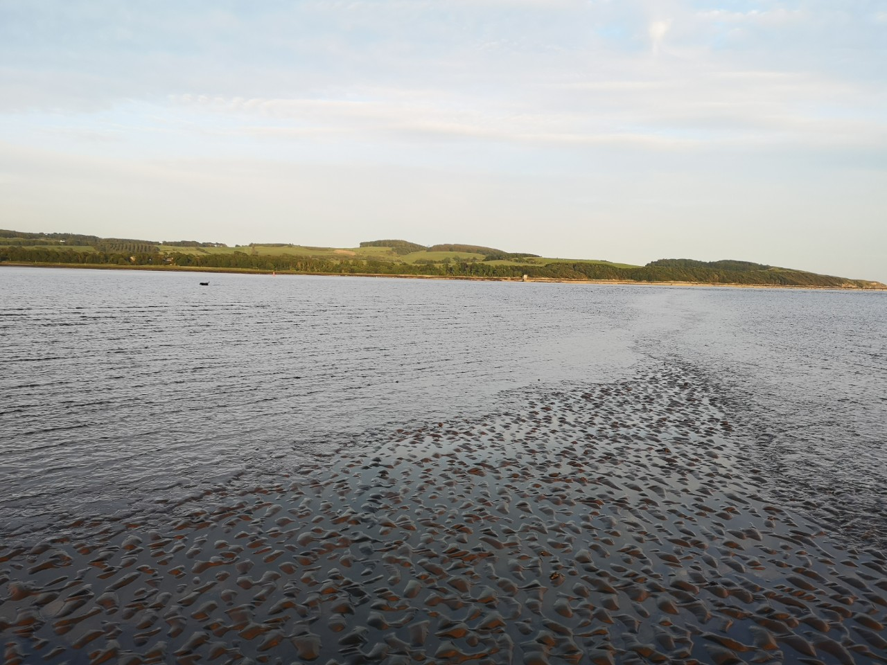 Tide coming in at Dhoon Bay Kirkcudbright with my dog fishing in the distance