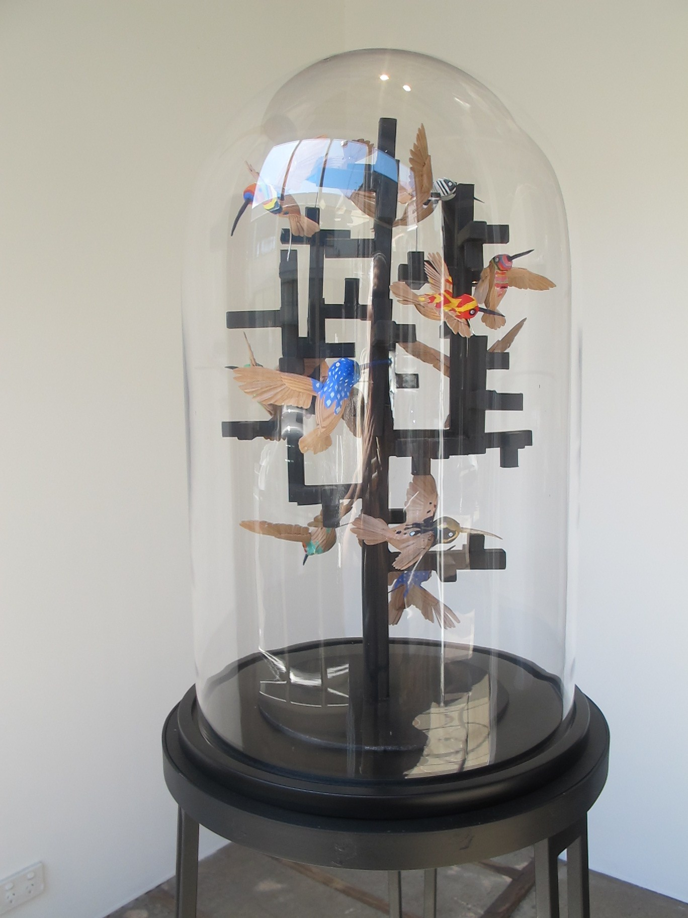 Simon MacEwan, Peace through understanding , 2011, steel, handcrafted cedar birds, gouache, glass dome, 160 x 40 x 40cm