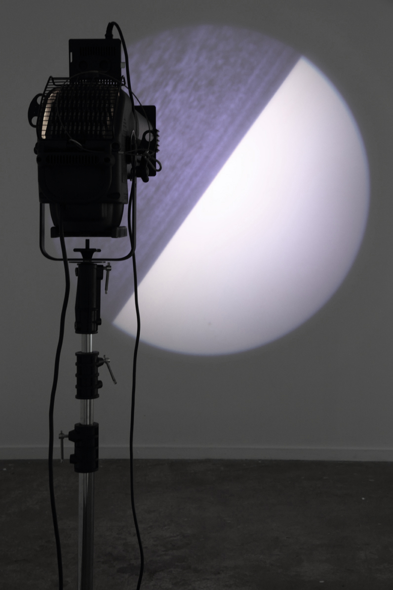Michaela Gleave, Orbit , 2012-2014, glass gobo slide, gobo rotator, theatre spotlight, stand, 100 x 80 x 190cm, 2 minute rotation
