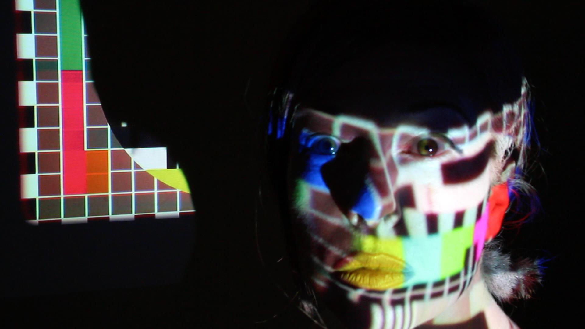 Sue Dodd, Test Pattern 1, Fil0ming the people , video production still, digital print, 73 x 43cm