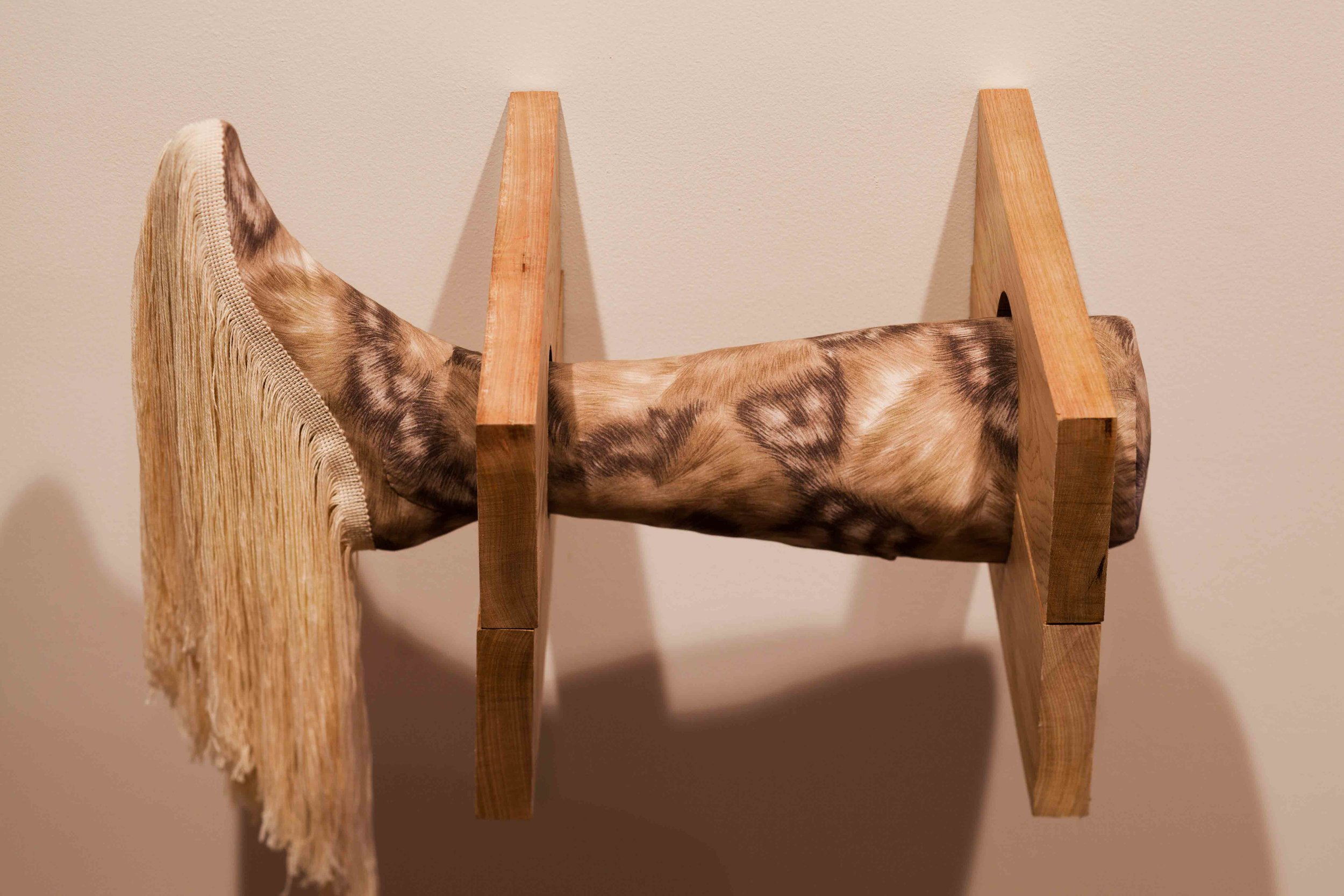 Julia Robinson,  Predicament , 2011, fabric, foam, fringing, timber, plaster, fixings, 1800 x 80 x 15cm