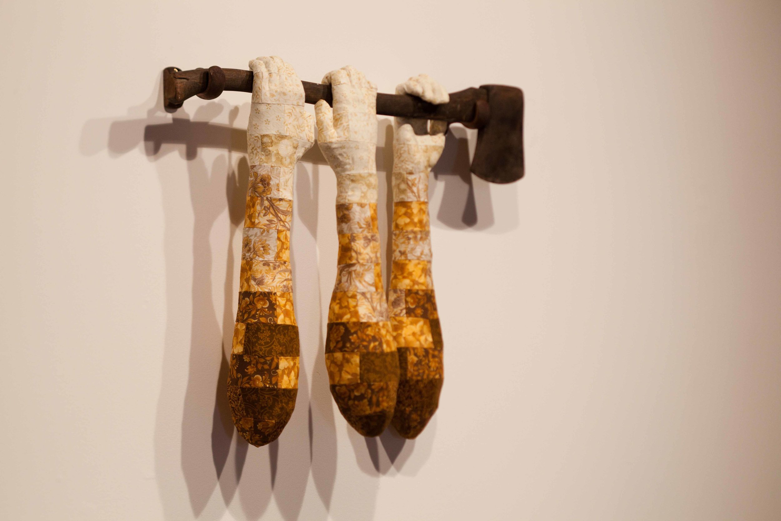 Julia Robinson,  Bloody deeds , 2011, fabric, thread, axe, plaster, foam, timber, 65 x 80 x 20cm