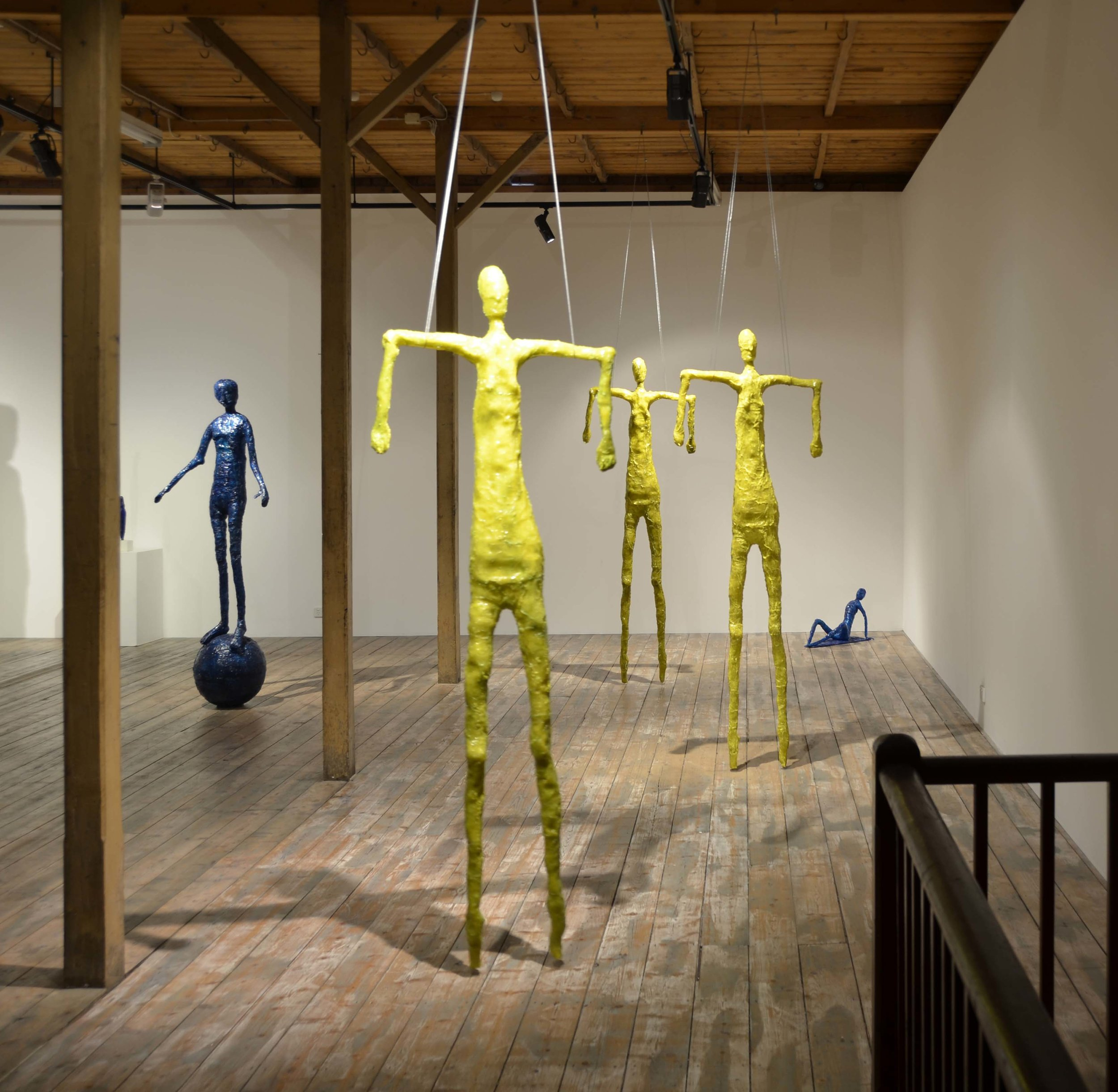 Elisabeth Weissensteiner,  Three Yellow Dancers Floating,  installation view, 2011, polyester resin, fibreglass and pigments, height 220cm each