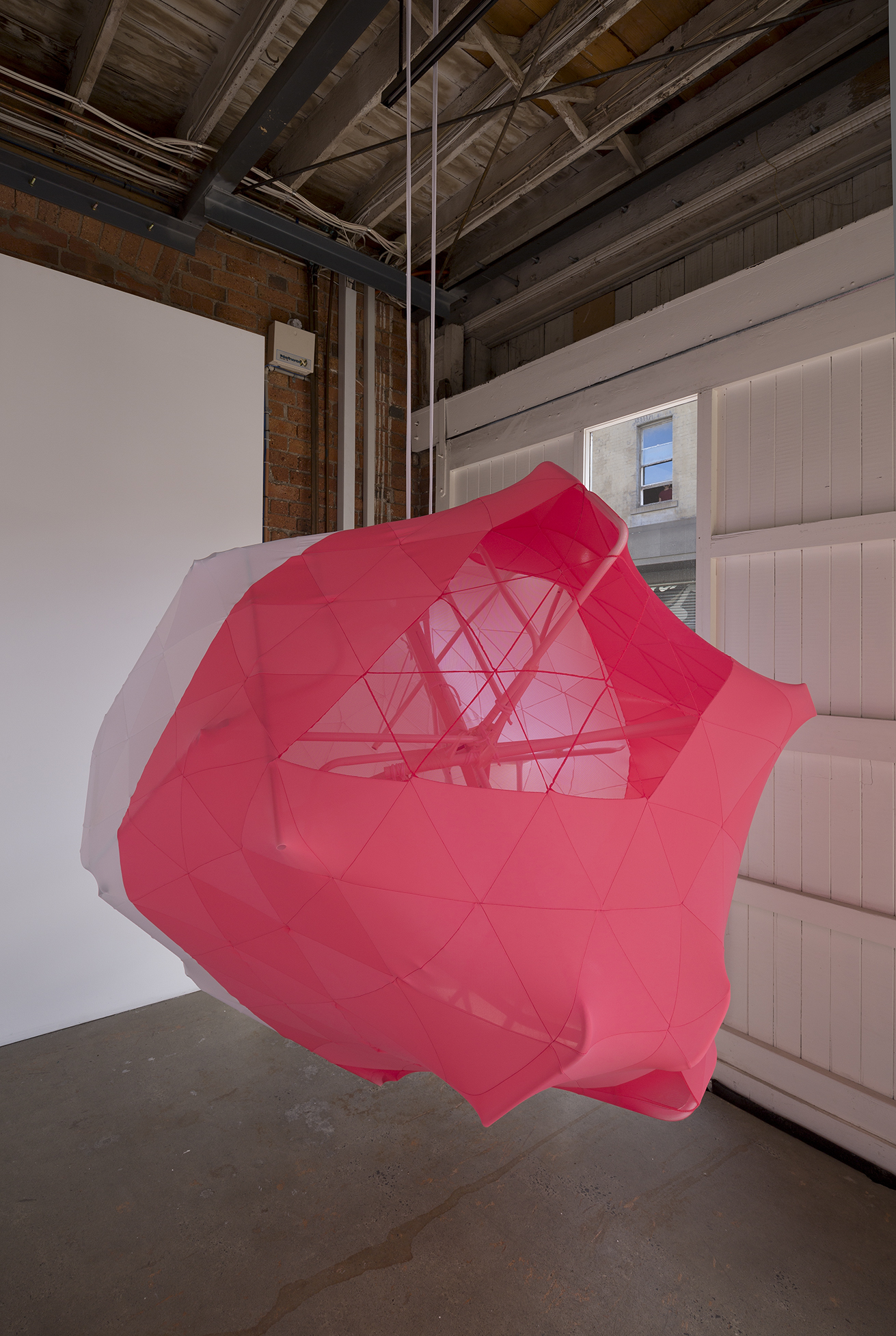 Melanie Irwin, Hemispherical Envelope (Coral, White), 2017, Found modified metal frames, lycra, cotton twine, electrical tape
