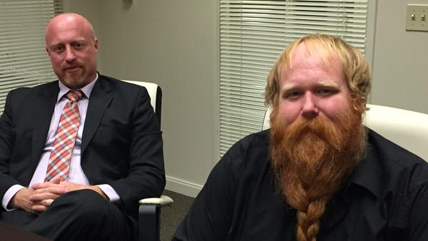 Licensed medical cannabis growers Ted Hicks, left, and Ryan Mears of Big Red Farms, in their attorney's Sacramento office, were the subject of an armed law enforcement raid in September, though they are considered by Yolo County officials to be model growers. (Robin Abcarian / Los Angeles Times)