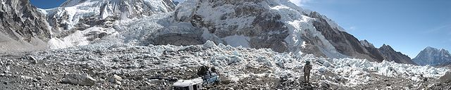 A view of Everest base camp with the Khumbu Icefall to the left. In the center are the remains of a helicopter that crashed in 2003.                                                    Photo by  Nuno Nogueira (  Nmnogueira  )