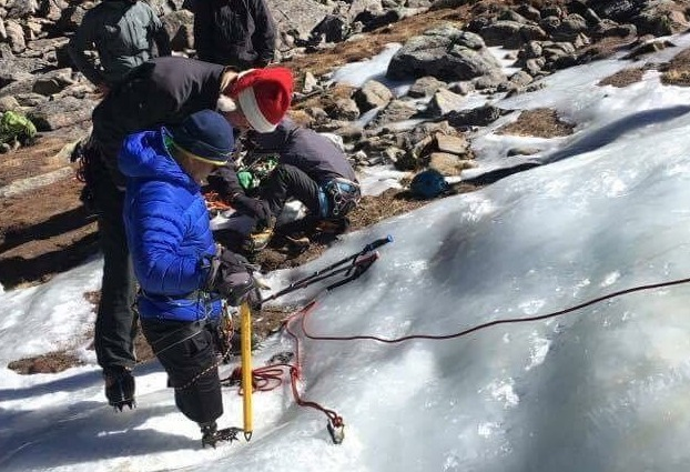 Hari practices climbing on ice.