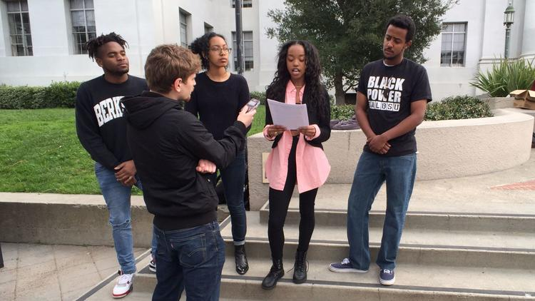 Members of the Cal BSU's executive board host a press release in order to place pressure on the University to secure permanent funding for the Fannie Lou Hamer Black Resource Center. From left to right: Anthony Gilmore (Financial Director), Niyatt Mengis (Leadership Development Director), AJ Moultrié (Communications Director), and Elias Hinit (Chair) along with an LA Times journalist.