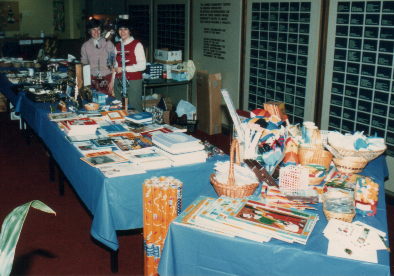 My Mom, on the right, running the Chanukah bazaar in the late 80s.