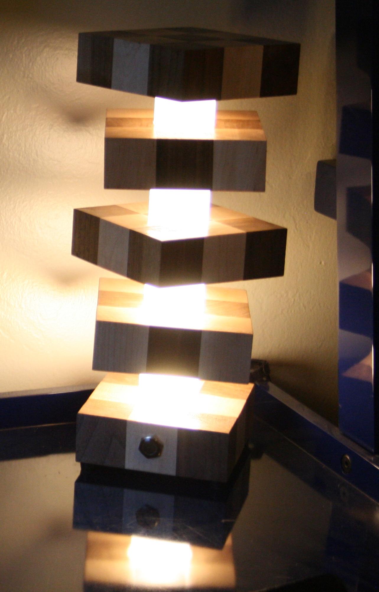 twisty-lamp-tower-on-at-night.JPG