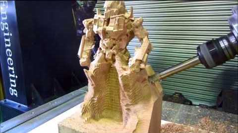This wood Transformer can only be done with a true 5-axis CNC; note the angle of the carving tool, which is a 4th axis.