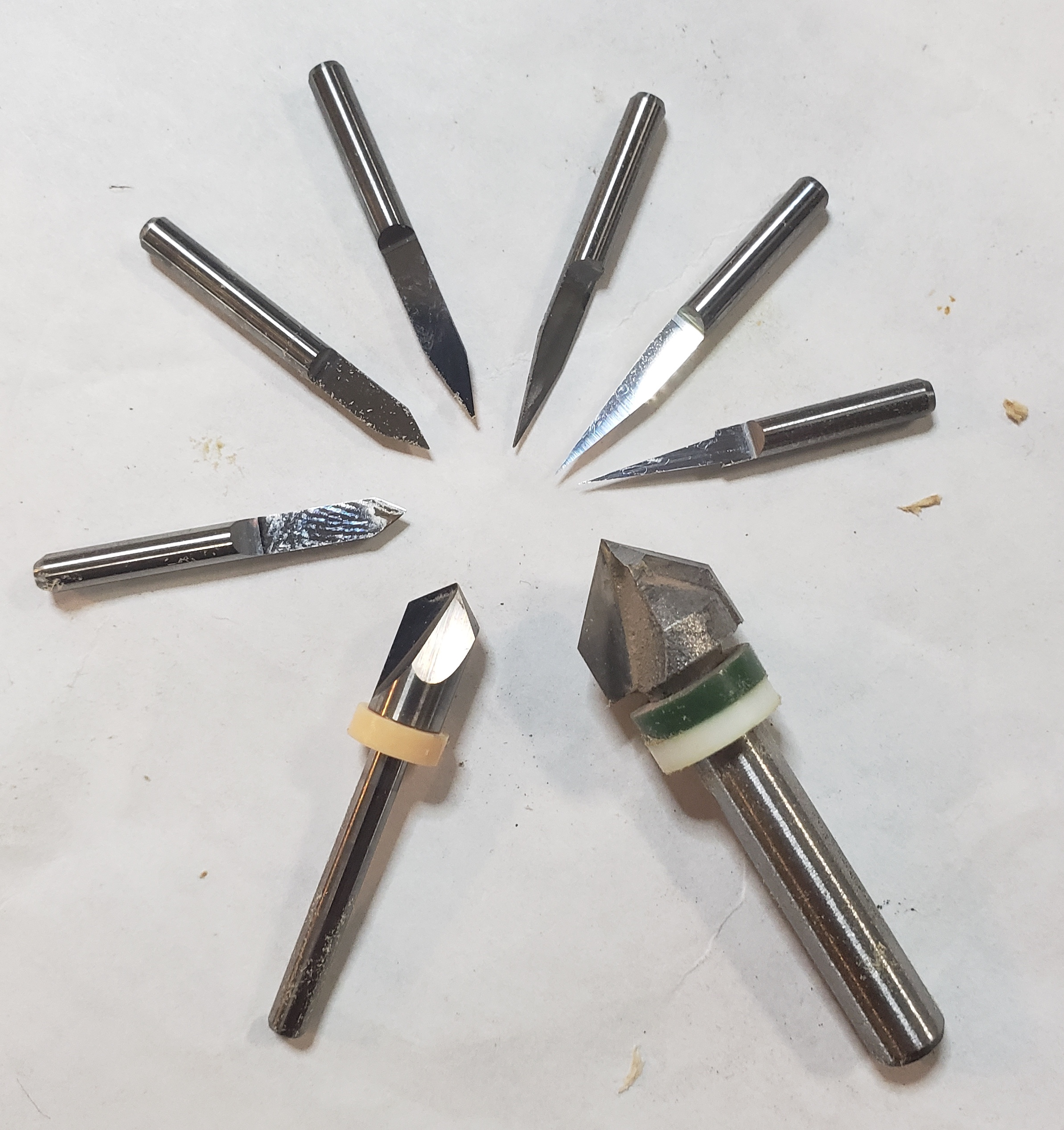 "Starting with the small bit at the 3 o'clock position and going counterclockwise, the  total  angle of these bits are 5, 10, 20, 30, 45, 60, and - with the two bigger bits - 90 & 90 degrees; the taper angle is half of the total angle. The first six all have a defined tip diameter of 0.1mm (= 1/250""), while the two larger bits don't have a tip diameter defined (but 0 or 0.1mm could be used). The total diameter of the second-through-sixth is 1/8""; the two bigger ones are 1/4"" and 1/2"" diameter. But look carefully: the first bit has a total diameter of about 3/32""; plunging deeper (or defining it as 1/8"" in software) could cause some unexpected results!"