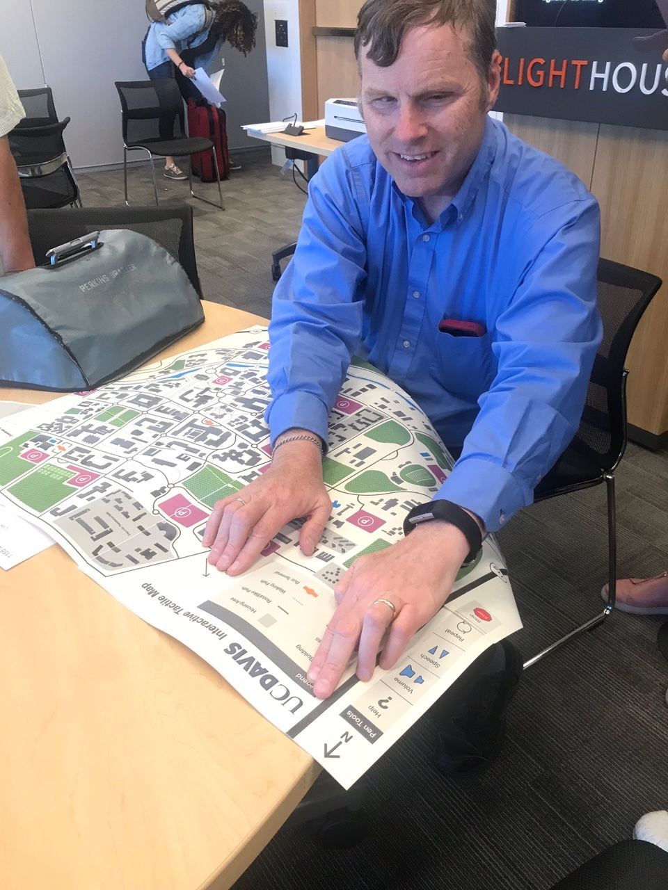 Frank Welte, Lighthouse Center for the Blind and Visually Impaired, tests the map and provides his input on the tactile design elements.