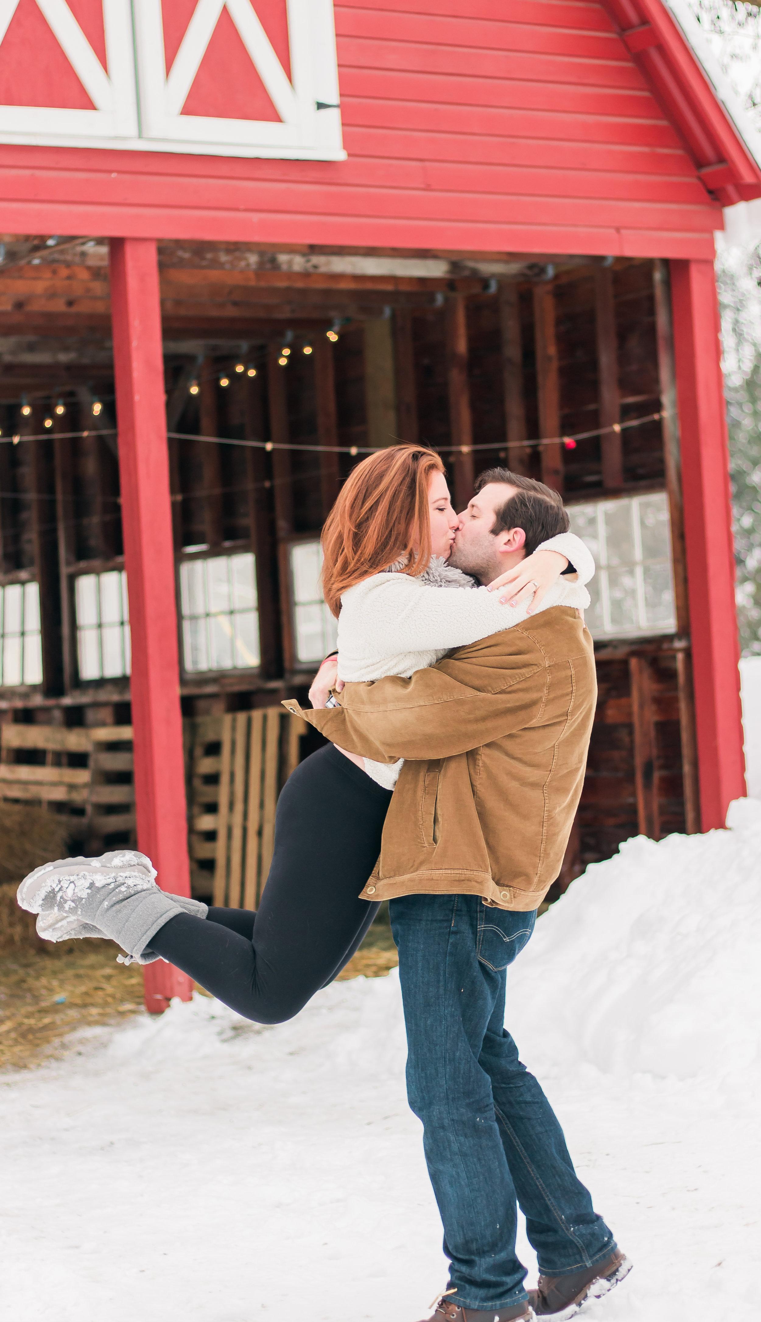 winter barn engagement photo