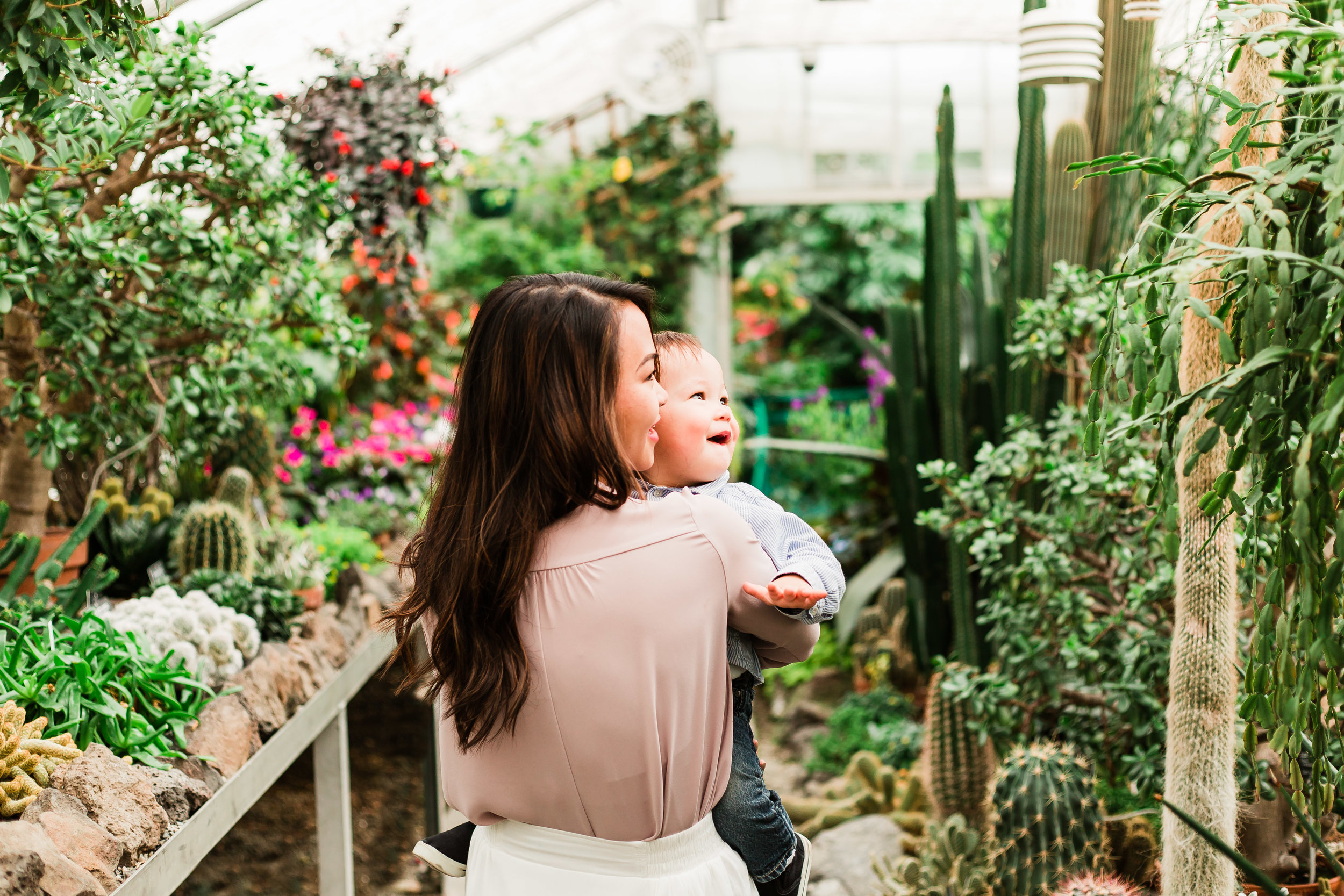 greenhouse photoshoot with mom and baby
