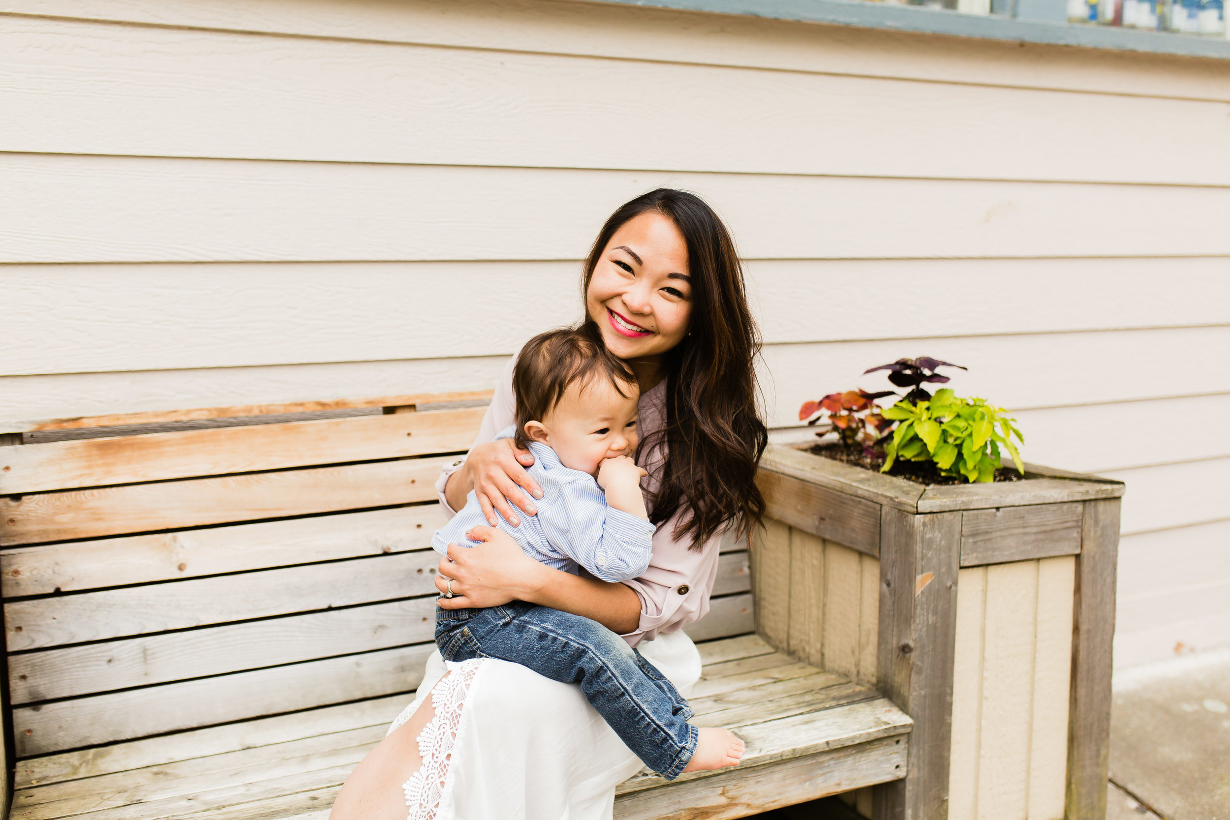 photo of mom and baby on a bench
