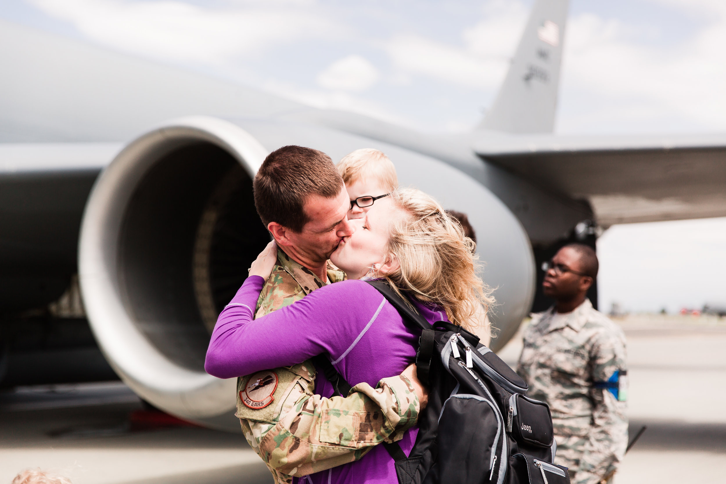 wife kissing soldier