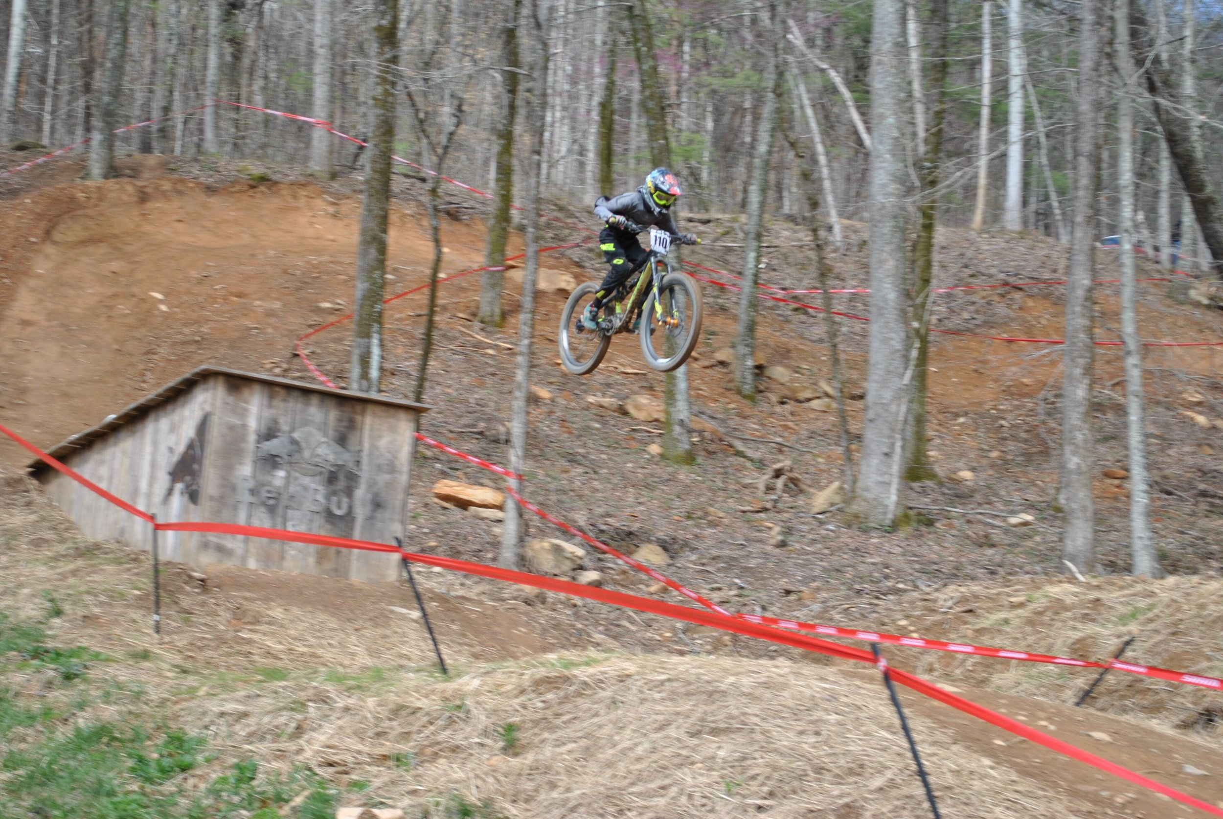 Christian Carbonell, Age 12, goes big at round two of Downhill Southeast at Windrock Bike Park.