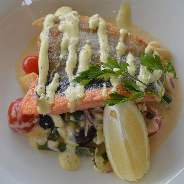 Crispy skinned fillet of Tasmanian salmon with preserved lemon risotto and a roasted tomato coulis #restaurantsaustralia #cheflife #foodporn #tasty #fresh #atlanticsalmon #catchoftheday