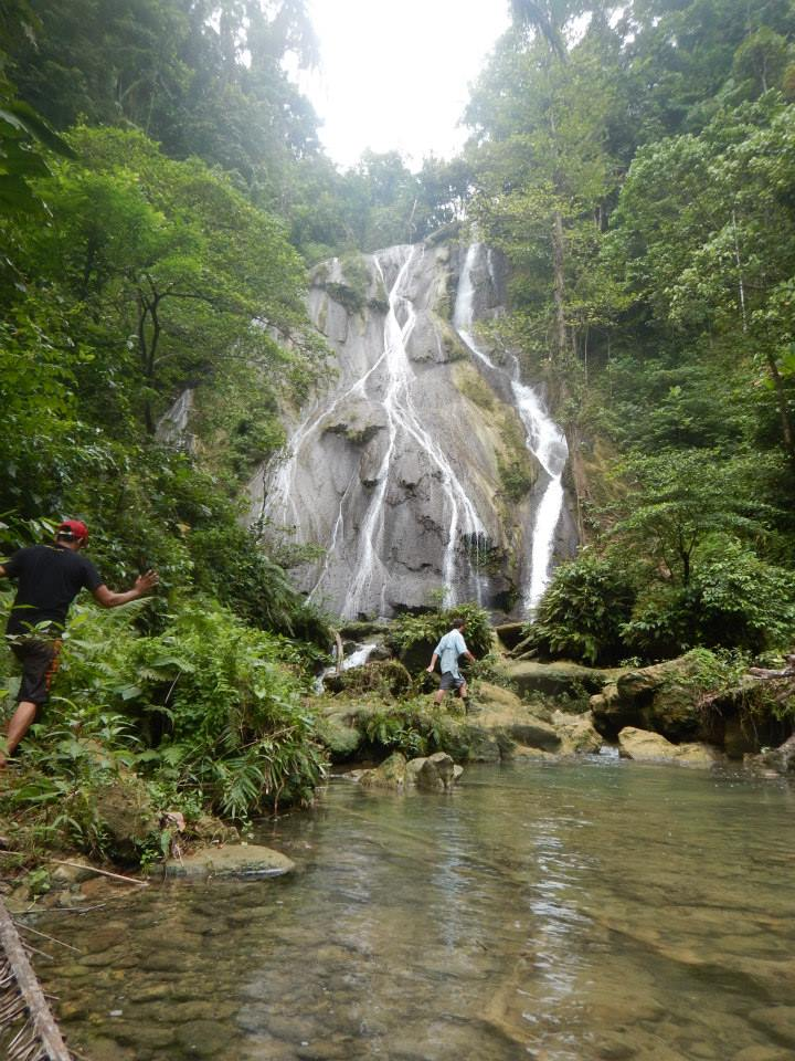 Hiking up streams in to sample freshwater gobies. Ambon, Indonesia.