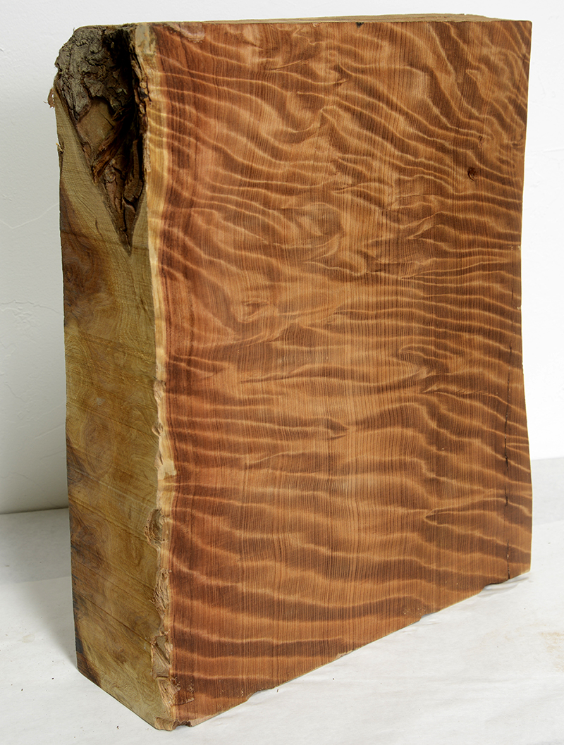 a massive block of highly figured/flamed vertical-grain reclaimed old growth redwood.