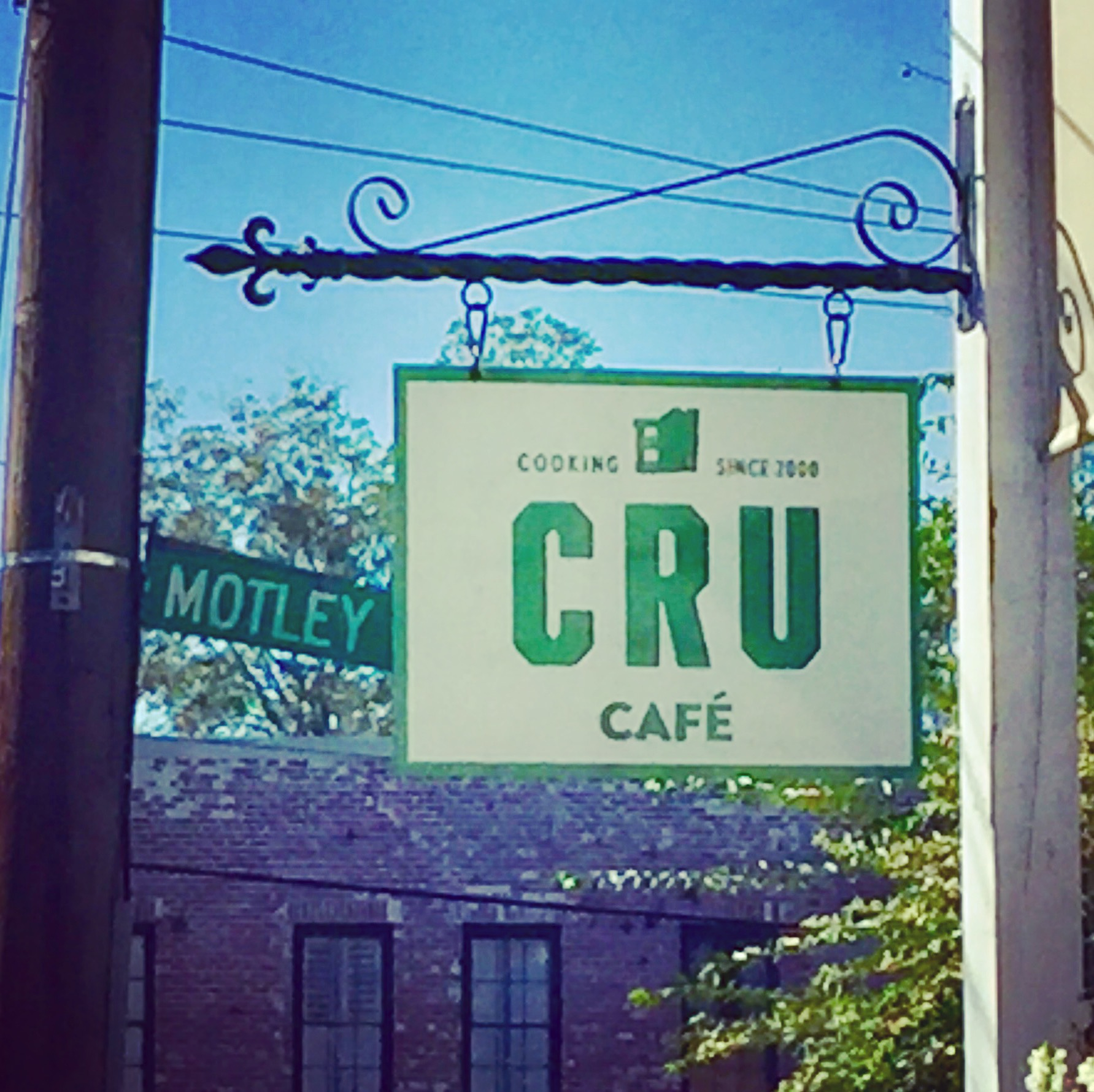 An interesting juxtaposition of signs at Cru Cafe.