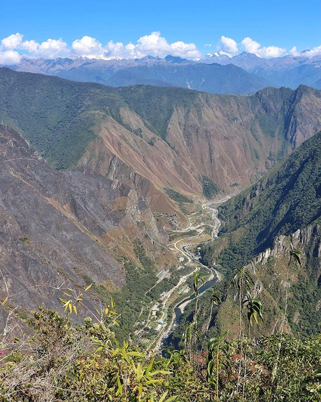 """One of the many gorgeous views from the top of Montaña Machu Picchu! . . There's more to see at Machu Picchu than the actual Incan village. You can also opt to do an additional hike (which means an additional permit!) up to Machu Picchu Mountain or Wayna/Huayna Picchu to see the views from WAY up. The top of Machu Picchu Mountain overlooks Aguas Calientes, a super quirky, cute town full of hotels, massage """"spas"""" and restaurants that only exist for Machu Picchu tourists."""