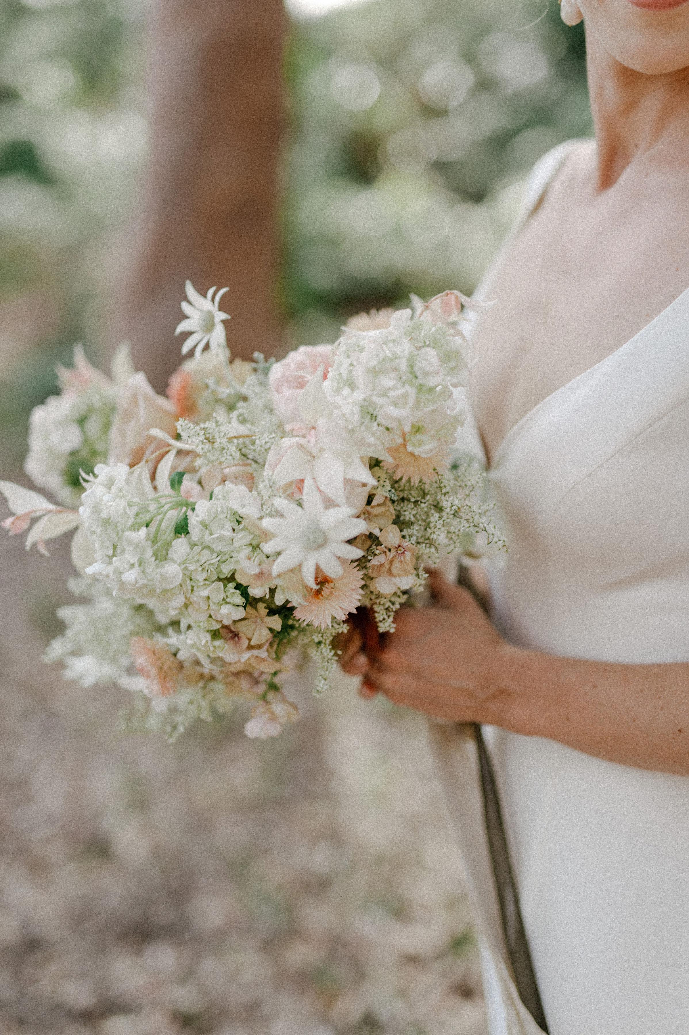 Romantic australian beach wedding. Textural and natural wedding flowers. Soft white bridal bouquet