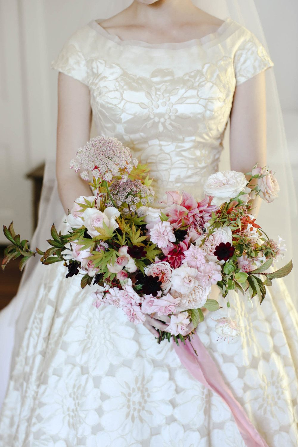 Autumn garden wedding. dahlias and roses bridal bouquet