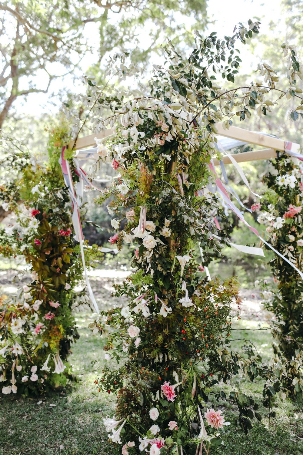 Autumn garden wedding. dahlias and roses.  Wild and organic chuppah