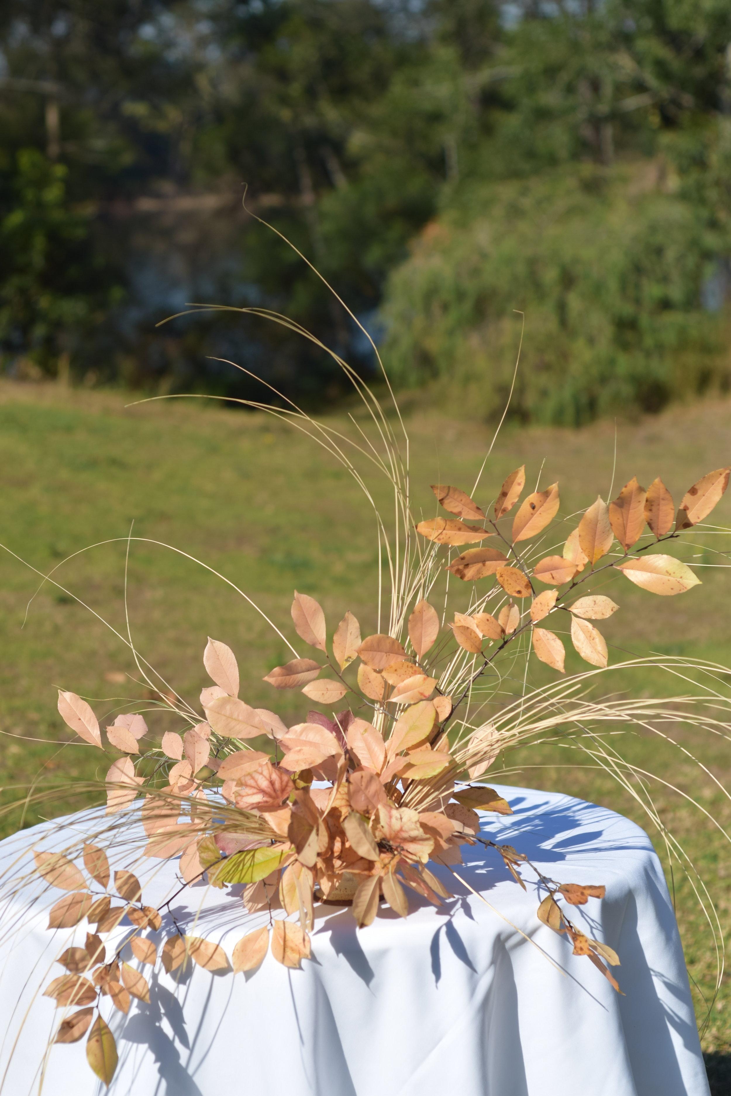 autumn foliage and dried grasses wedding flower arrangement