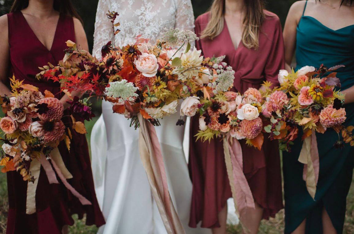 Autumn foliage wedding arch romantic and wild garden flowers