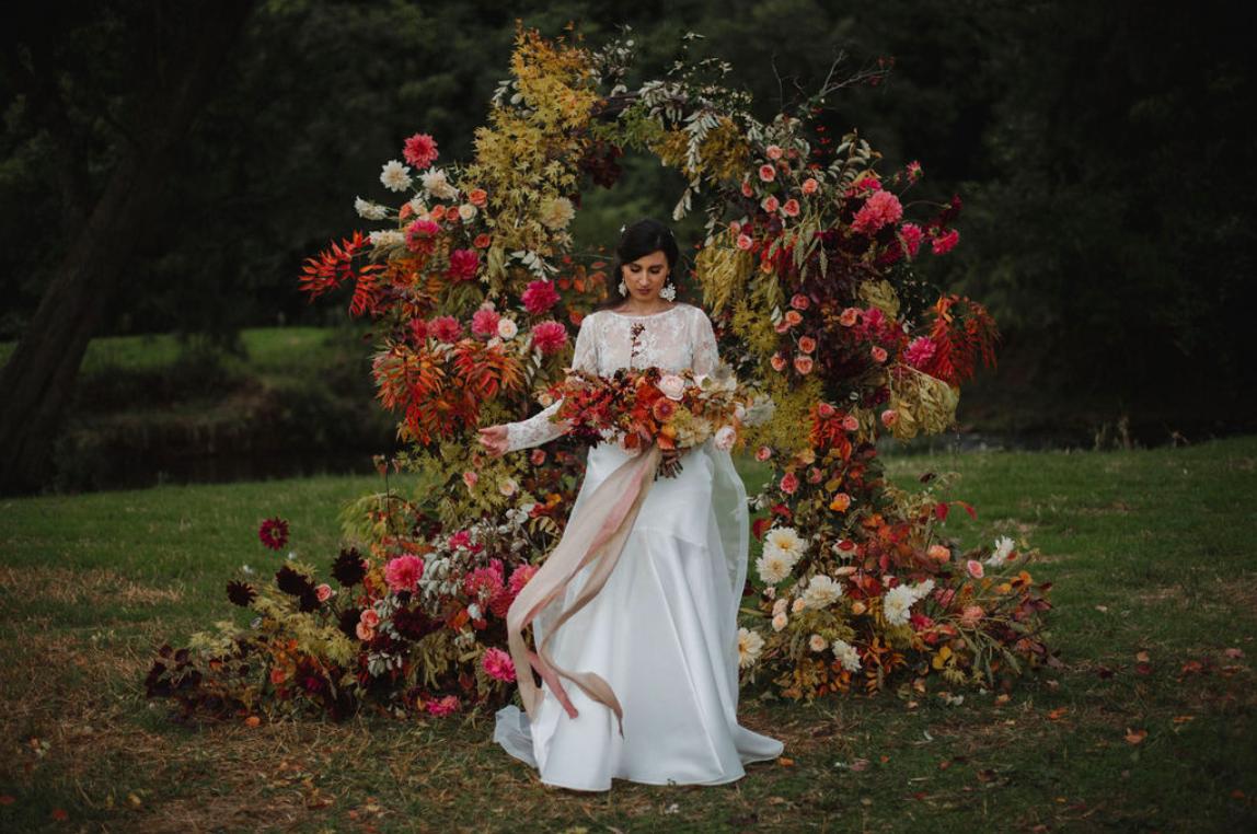 Autumn foliage wedding arch romantic and wild garden flowers